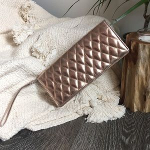 Rose gold quilted clutch with strap wristlet